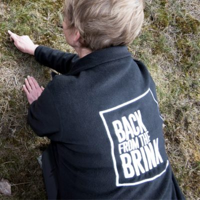 Image of volunteer wearing Back from the Brink branded fleece